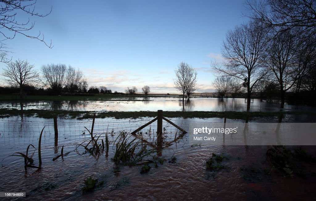 The sun reflects on the water in flooded fields and roads close to the village of North Curry on November 21, 2012 near Taunton, England. Heavy rain overnight has brought widespread disruption to many parts of the UK particularly in the Somerset and Wiltshire and weather forecasters have warned of more wet and windy weather to come.