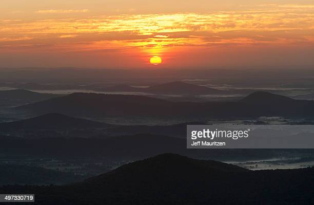 The sun rises above mist shrouded valleys in the Blue Ridge Mountains.
