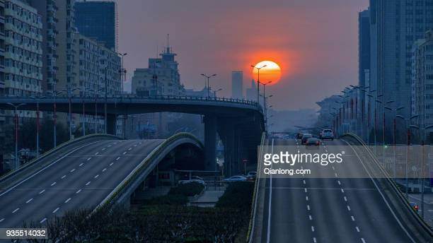 The sun rises above the Chang'an Avenue on the spring equinox day on March 21 2018 in Beijing China The spring equinox falls on Wednesday which marks...