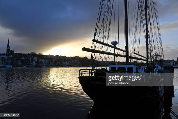 The sun rises above the Flensburg Fjord in Flensburg Germany 30 January 2018 Sunny weather with a chance of showers is expected in the North on...