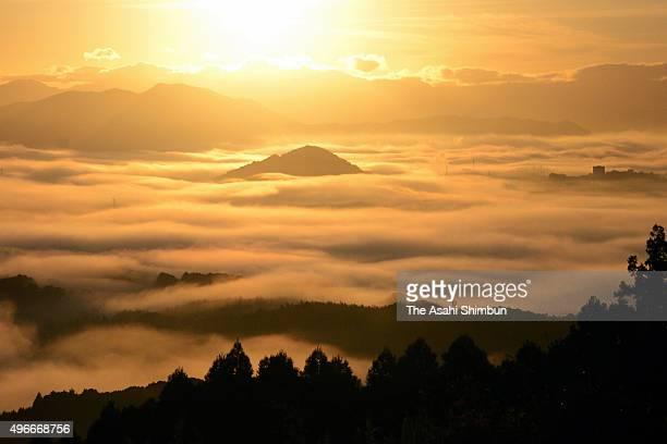 The sun rises above the sea of clouds on November 9 2015 in Iizuka Fukuoka Japan