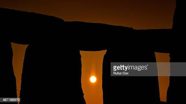 The sun rises at Stonehenge as revellers gather to celebrate the spring equinox on March 21 2015 in Wiltshire England An estimated 700 pagans druids...