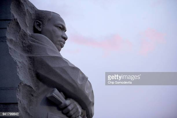 The sun rises at the Dr Martin Luther King Jr Memorial on the 50th anniversary of King's assassination April 4 2018 in Washington DC A prayer march...