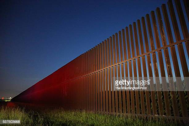 The sun rises at the US Mexico border in Brownsville Texas on Sunday May 15 2016