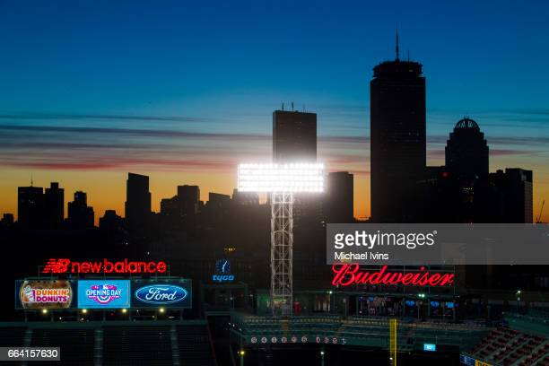The sun rises before an opening day game between the Boston Red Sox and the Pittsburgh Pirates at Fenway Park on April 3 2017 in Boston Massachusetts