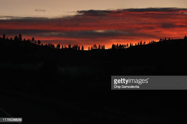 The sun rises behind a ridge of trees September 13 2019 near Missoula Montana According to the 2017 Montana Climate Assessment the annual average...