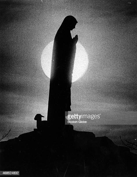 The sun rises behind a statue of Our Lady of Fatima at Ephpheta House Oblate Fathers Retreat House in Cumberland RI on April 11 1979