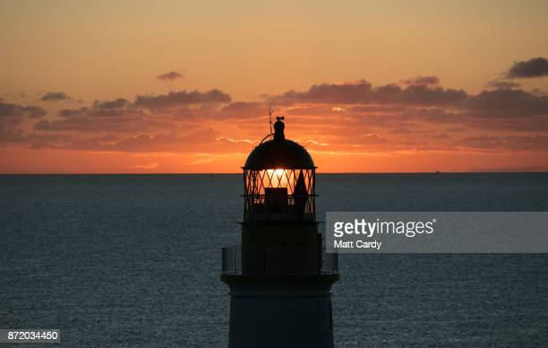The sun rises behind Douglas Head lighthouse on November 7, 2017 in Douglas, Isle of Man. The Isle of Man is a low-tax British Crown Dependency with...