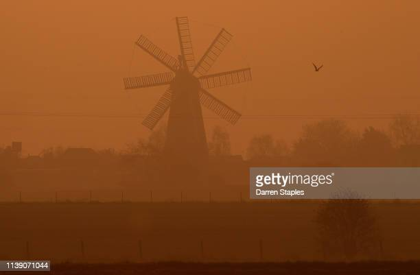 The sun rises behind Heckington Windmill on March 29 2019 near Boston England The town of Boston in Lincolnshire voted with a 75% majority to leave...