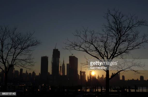 The sun rises behind Hudson Yards and the Empire State Building in New York City on November 25 as seen from Weehawken New Jersey