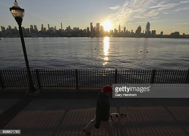 The sun rises behind midtown Manhattan in New York City on January 16, 2017 as seen from Weehawken, NJ.