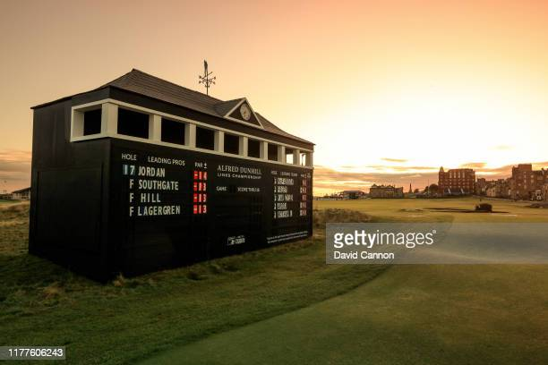 The sun rises behind the Alfred Dunhill scoreboard beside the 17th green during the third round of the Alfred Dunhill Links Championship on the Old...