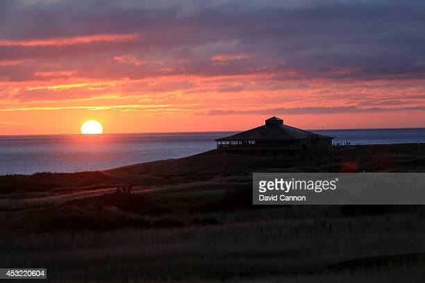 The sun rises behind the clubhouse at The Fairmont St Andrews Bay Golf Resort on July 30 2014 in St Andrews Scotland