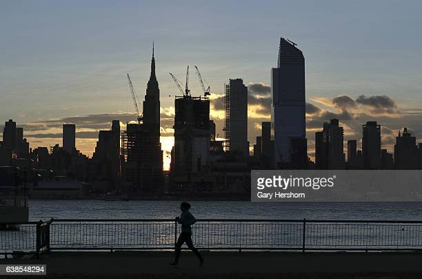 The sun rises behind the Empire State Building and Hudson Yards in New York City on January 13 as seen from Weehawken, NJ.