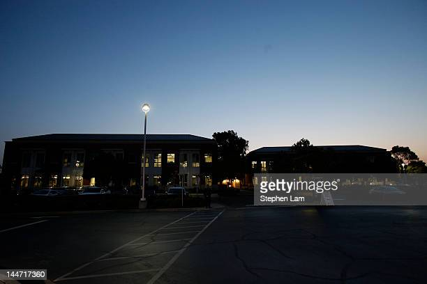 The sun rises behind the Facebook headquarters on May 18 2012 in Menlo Park California The eightyearold social network company listed their initial...