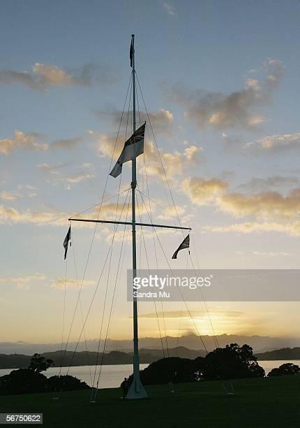 The sun rises behind the flag pole during the dawn service to celebrate Waitangi Day February 6 2006 in Waitangi New Zealand Waitangi Day is a public...