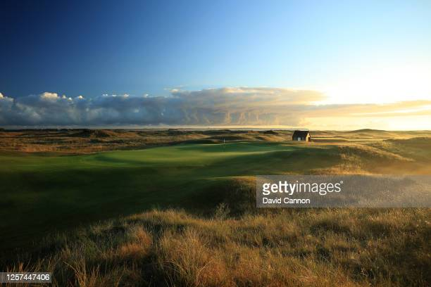 The sun rises behind the green on the par 4 second hole at The Royal St George's Golf Club on July 20 2020 in Sandwich England