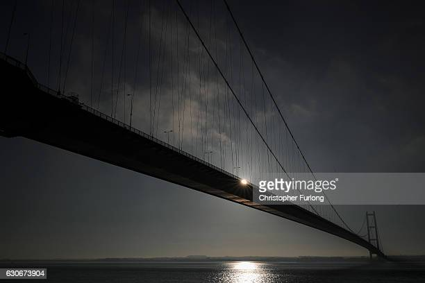 The sun rises behind the Humber Bridge as the City of Hull gets ready to be the offical 2017 UK City of Culture on December 29 2016 in Hull England...