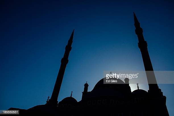 The sun rises behind the Muhammad Ali Mosque in Cairo's Citadel on October 21 2013 in Cairo Egypt The Muhammad Ali Mosque completed in the 1850's is...