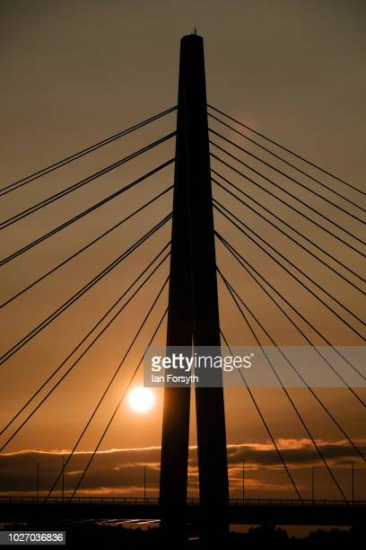 The sun rises behind the new Northern Spire bridge spanning the River Wear on the day that it opens for a pedestrian walkover on August 28 2018 in...