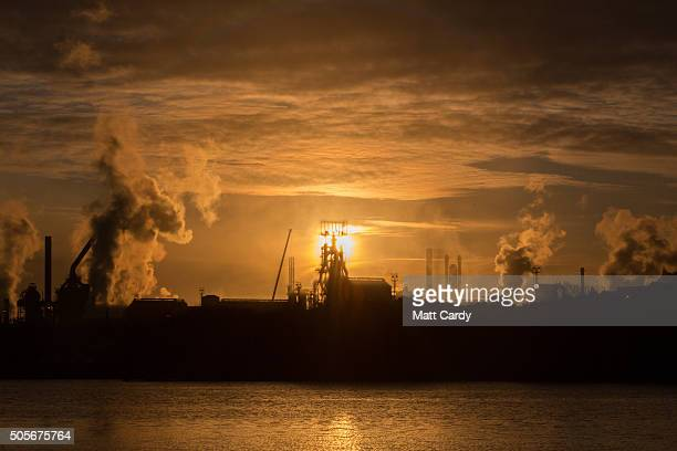 The sun rises behind the Tata steelworks on January 19 2016 in Port Talbot Wales Tata Steel announced yesterday that it plans to cut 1050 jobs in the...