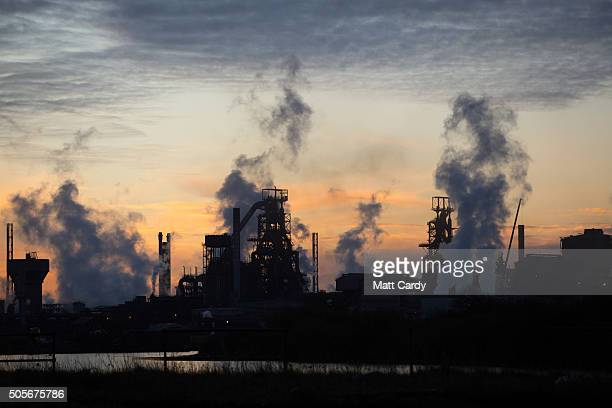 The sun rises behind the Tata steelworks on January 19, 2016 in Port Talbot, Wales. Tata Steel announced yesterday that it plans to cut 1,050 jobs in...