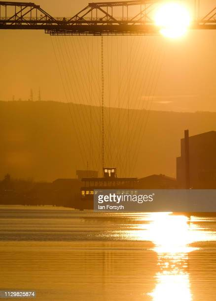 The sun rises behind the Tees Transporter Bridge on February 15 2019 in Middlesbrough England The Tees Transporter Bridge often referred to as the...