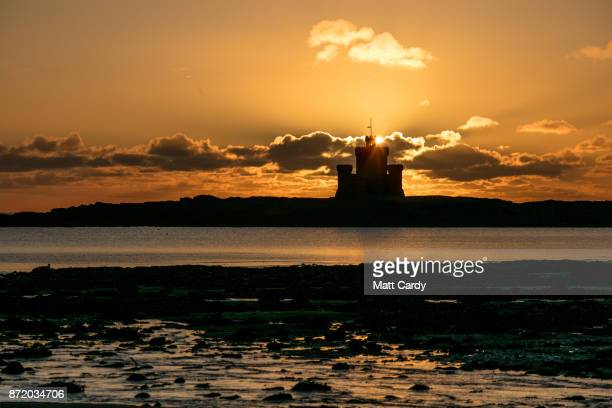 The sun rises behind the Tower of Refuge on November 7 2017 in Douglas Isle of Man The Isle of Man is a lowtax British Crown Dependency with a...