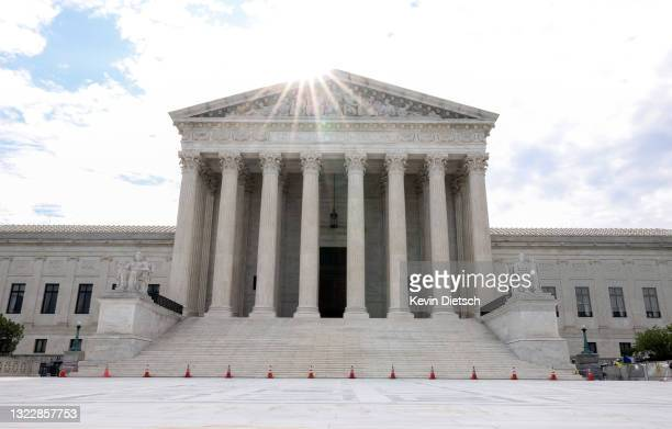 The sun rises behind the U.S. Supreme Court on June 10, 2021 in Washington, DC. The Court is expected to release rulings later today.