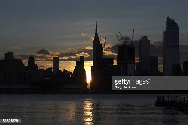 The sun rises down 34th street in New York City on January 13 as seen from Weehawken, NJ.