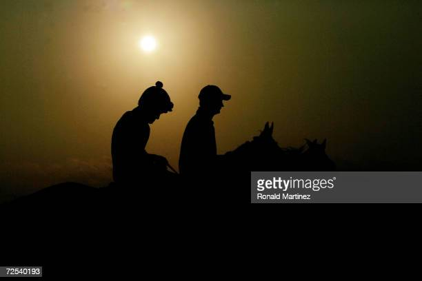 The sun rises during morning workouts at the Breeders' Cup World Thoroughbred Championships on October 29 2004 at Lone Star Park in Grand Prairie...