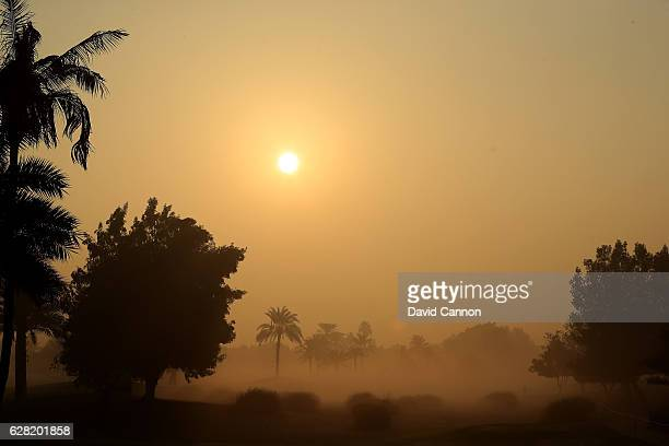 The sun rises looking down the tenth hole through the ealry morning fog that led to a one delay in play during the first round of the 2016 Omega...