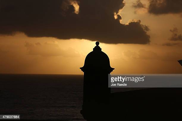 The sun rises near a guard tower at Fort San Felipe del Morro a day after Puerto Rican Governor Alejandro Garcia Padilla gave a speech regarding the...