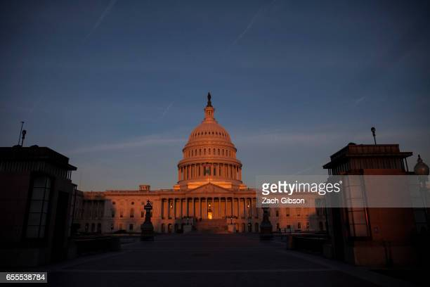 The sun rises near The United States Capitol Building on March 20 2017 in Washington DC The Senate will hold a confirmation hearing for Supreme Court...