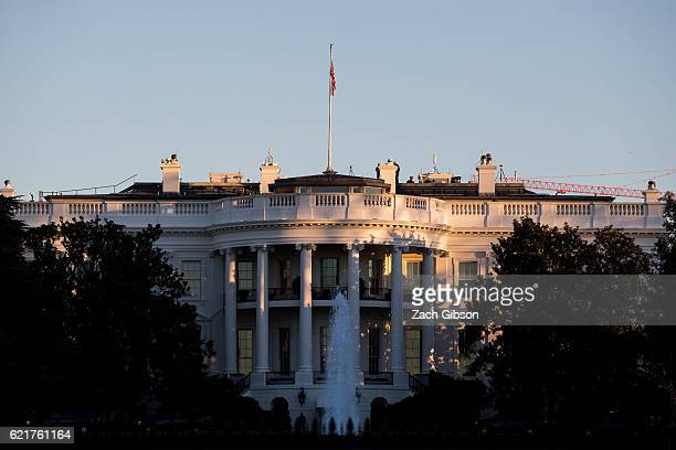 The sun rises near the White House on November 8 2016 in Washington DC Americans today will choose between Republican presidential candidate Donald...