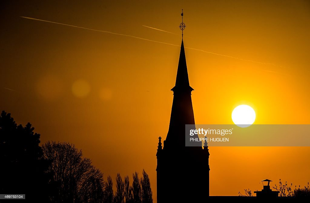 The sun rises on April 15, 2015 in the northern French town of Godewaersvelde.