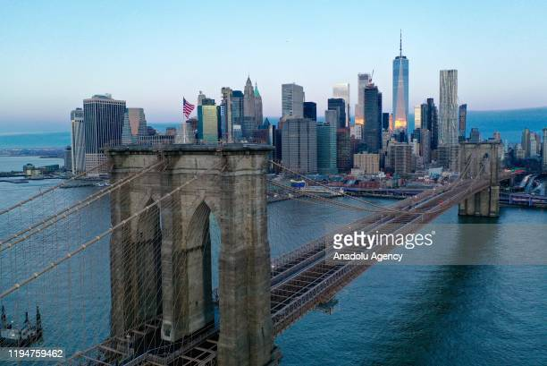 The sun rises on Brooklyn Bridge in New York United States on January 19 2020