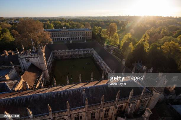The sun rises on Magdalen College at Oxford University on May 1 2018 in Oxford England This 500 year old May Day tradition is sung to welcome Spring...