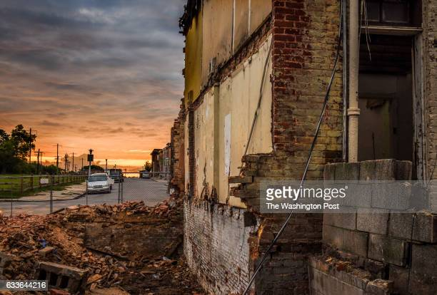 The sun rises on the last hours of the sole remaining row house on N Bradford street on August 2016 in Baltimore MD