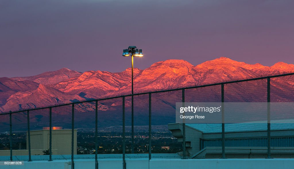 The sun rises on the mountains to the west as viewed on December 8, 2015 in Las Vegas, Nevada. Tourism in America's 'Sin City' has, within the past two years, made a significant comeback following the Great Recession, with visitors filling the hotels, restaurants, and casinos in record numbers.