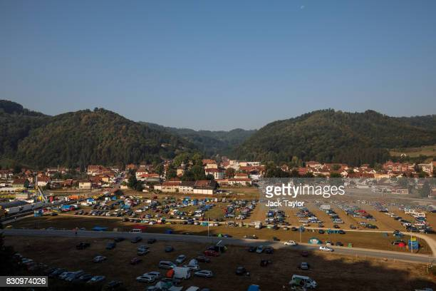 The sun rises on the town of Guca during the Guca Trumpet Festival on August 12 2017 in Guca Serbia Thousands of revellers attend the trumpet...