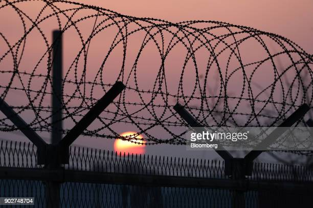 The sun rises over a barbedwire fence at a military check point on the Unification Bridge linked to North Korea near the demilitarized zone in Paju...