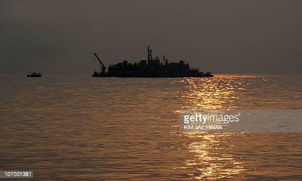 The sun rises over a South Korea Navy mobile base off Yeonpyeong island on November 30 2010 South Korea deployed rocket launchers and extra artillery...