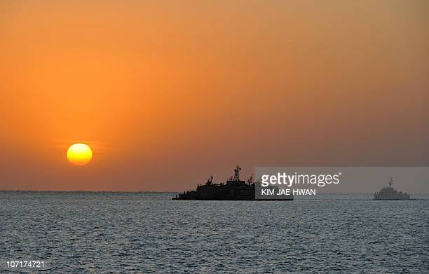 The sun rises over a South Korean Navy mobile base off Yeonpyeong Island on November 28 2010 five days after the North stunned the world by launching...
