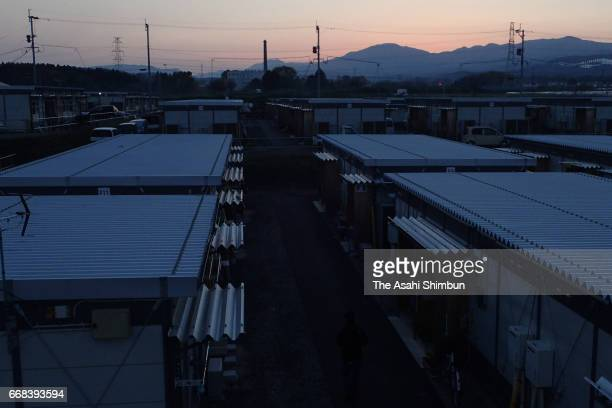 The sun rises over a temporary housing on the first anniversary of a series of earthquakes on April 14, 2017 in Mashiki, Kumamoto, Japan. While 50...