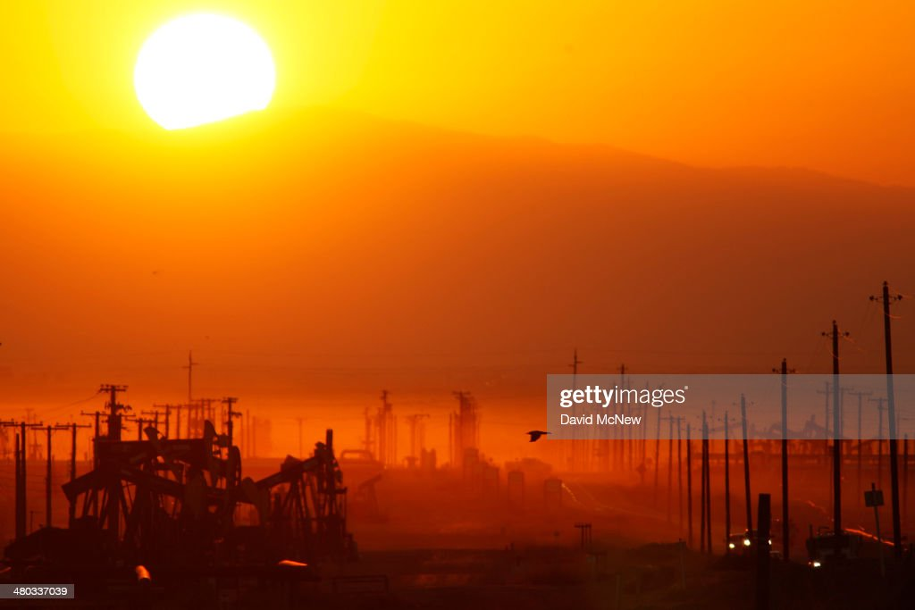 The sun rises over an oil field over the Monterey Shale formation where gas and oil extraction using hydraulic fracturing, or fracking, is on the verge of a boom on March 24, 2014 near Lost Hills, California. Critics of fracking in California cite concerns over water usage and possible chemical pollution of ground water sources as California farmers are forced to leave unprecedented expanses of fields fallow in one of the worst droughts in California history. Concerns also include the possibility of earthquakes triggered by the fracking process which injects water, sand and various chemicals under high pressure into the ground to break the rock to release oil and gas for extraction though a well. The 800-mile-long San Andreas Fault runs north and south on the western side of the Monterey Formation in the Central Valley and is thought to be the most dangerous fault in the nation. Proponents of the fracking boom saying that the expansion of petroleum extraction is good for the economy and security by developing more domestic energy sources and increasing gas and oil exports.