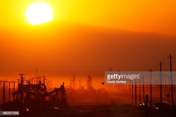 The sun rises over an oil field over the Monterey Shale formation where gas and oil extraction using hydraulic fracturing, or fracking, is on the...