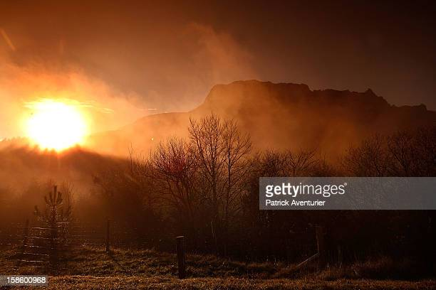 The sun rises over Bugarath the small village in the foothills of the Pyrenees on December 20 2012 in Bugarach France Miviludes the French...