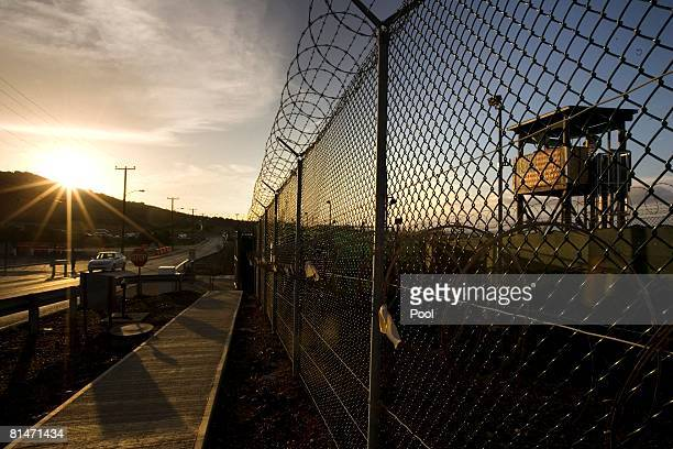The sun rises over Camp Delta detention compound which has housed foreign prisoners since 2002 at Guantanamo Bay US Naval Base June 6 2008 in Cuba...