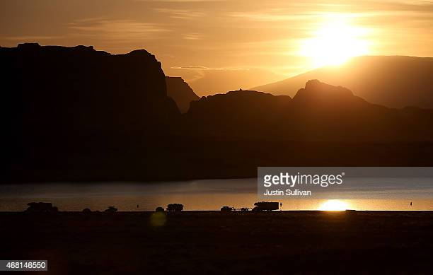 The sun rises over campers at Lake Powell's Lone Rock Camp on March 30 2015 near Big Water Utah As severe drought grips parts of the Western United...